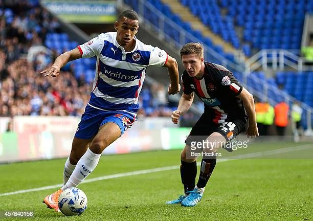 Nick Blackman of Reading advances under pressure from John Lundstram of Blackpool during the Sky Bet Championship match between Reading and Blackpool...