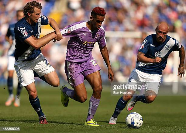 Nick Blackman of Reading holds off pressure from Jonathan Spector and David Cotterill of Birmingham during the Sky Bet Championship match between...