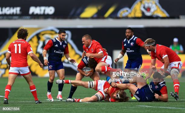 Nick Blevins of Canada tackles AJ MacGinty of the USA during the second half of a Rugby World Cup 2019 Qualifier match at Tim Hortons Field on June...