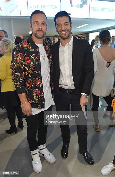 Nick Blood and Simon Kassianides attends the Murad LA Flagship Store Grand Opening on November 5 2014 in Los Angeles California