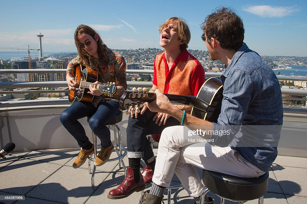 Nick Bockrath, Matt Shultz and Matthan Minster of Cage the Elephant perform an EndSession on the roof-deck at the 107.7 The End radio station on August 27, 2014 in Seattle, Washington.