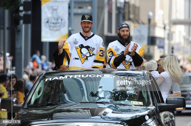 Nick Bonino and Matt Murray of the Pittsburgh Penguins ride in the Victory Parade and Rally on June 14 2017 in Pittsburgh Pennsylvania
