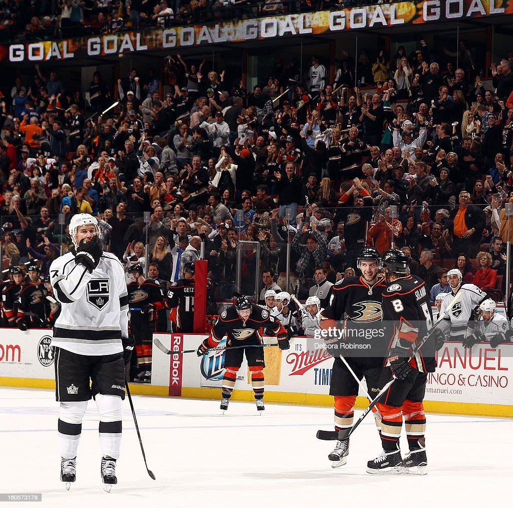 Nick Bonino #13 and Teemu Selanne #8 of the Anaheim Ducks celebrate a goal scored during the game as Jeff Carter #77 of the Los Angeles Kings skates by on February 2, 2013 at Honda Center in Anaheim, California.