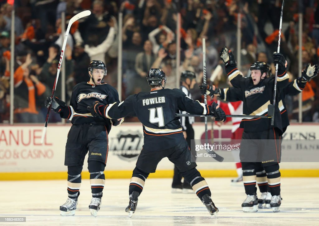Nick Bonino #13, Cam Fowler #4 and Matt Beleskey #39 of the Anaheim Ducks celebrate Bonino's game winning goal against the Detroit Red Wings in overtime in Game Five of the Western Conference Quarterfinals during the 2013 NHL Stanley Cup Playoffs at Honda Center on May 8, 2013 in Anaheim, California. The Ducks defeated the Red Wings 3-2 in overtime.