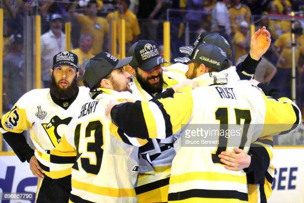 Nick Bonino Conor Sheary Justin Schultz and Bryan Rust of the Pittsburgh Penguins celebrates after defeating the Nashville Predators in Game Six of...