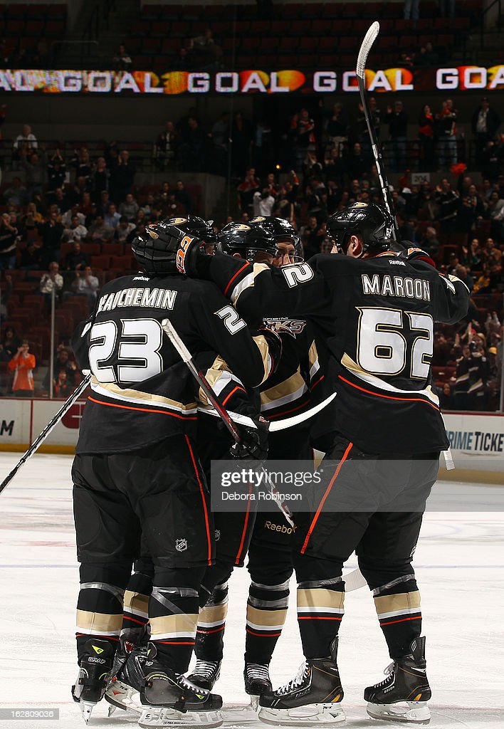 Nick Bonino #13, Emerson Etem #65, Francois Beauchemin #23 and Patrick Maroon #62 of the Anaheim Ducks celebrate a first period goal scored during the game against the Nashville Predators on February 27, 2013 at Honda Center in Anaheim, California.