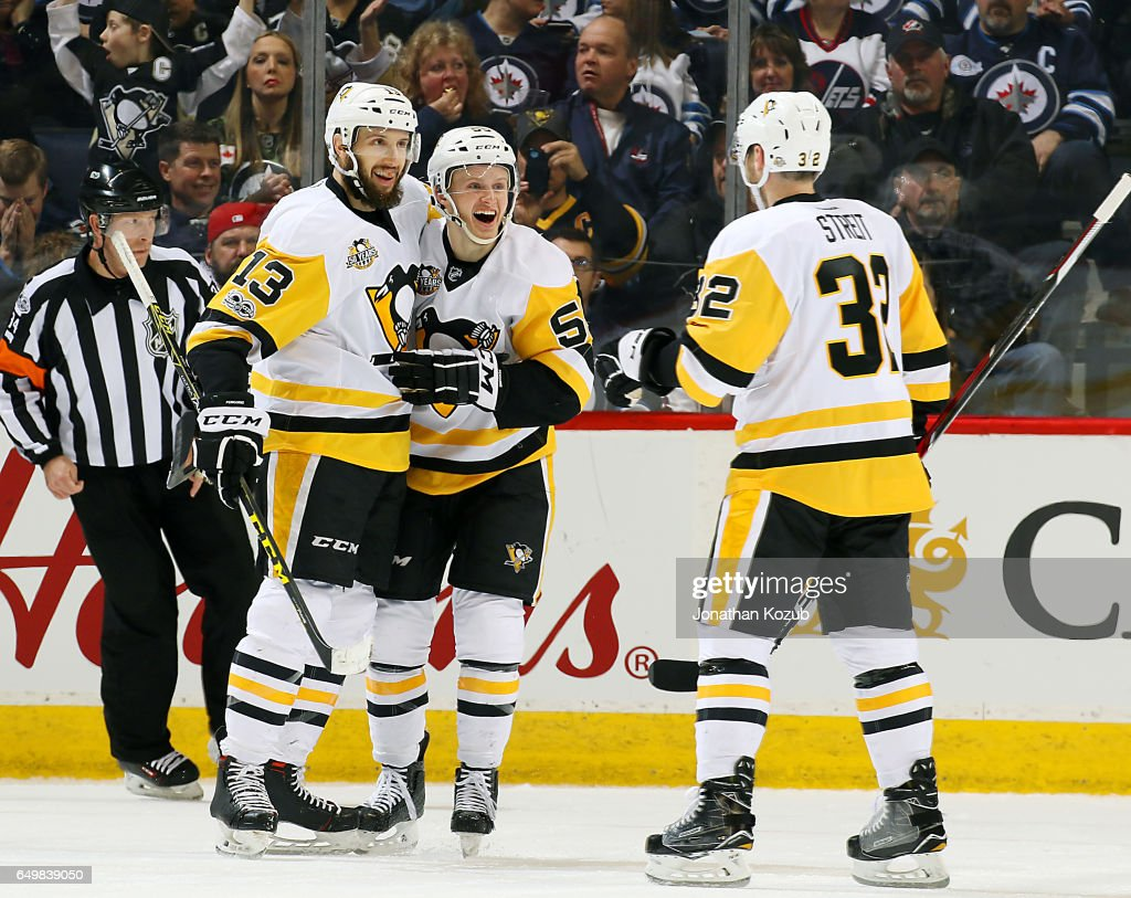 Nick Bonino #13, Jake Guentzel #59 and Mark Streit #32 of the Pittsburgh Penguins celebrate a second period goal against the Winnipeg Jets at the MTS Centre on March 8, 2017 in Winnipeg, Manitoba, Canada.