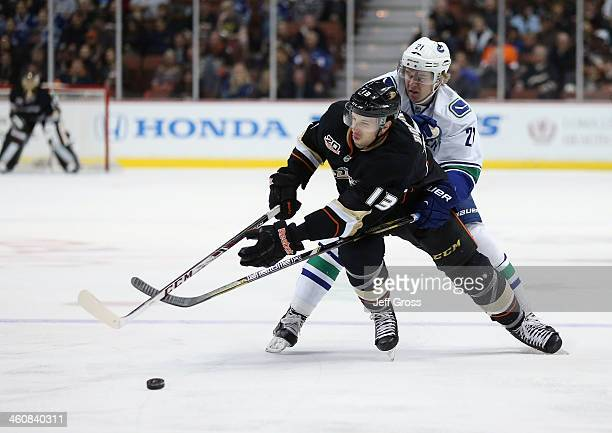 Nick Bonino of the Anaheim Ducks and Zac Dalpe of the Vancouver Canucks fight for the puck in the first period at Honda Center on January 5 2014 in...