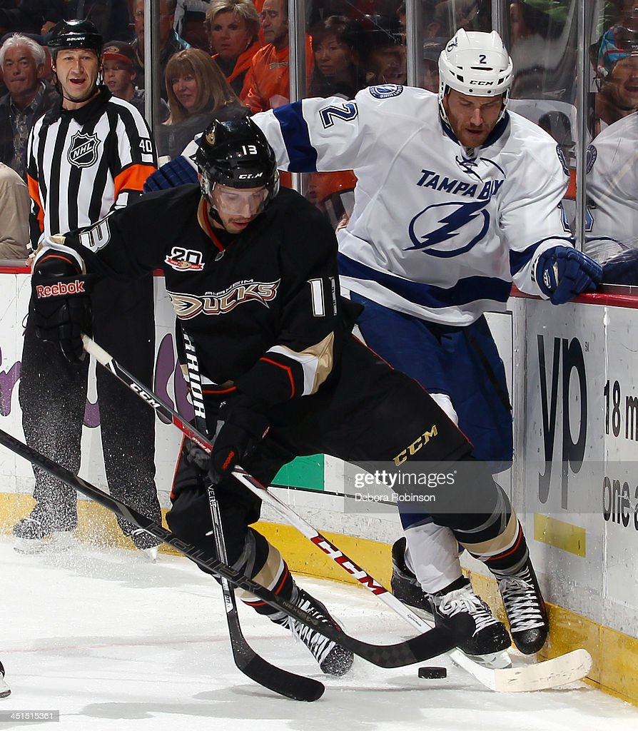 <a gi-track='captionPersonalityLinkClicked' href=/galleries/search?phrase=Nick+Bonino&family=editorial&specificpeople=5805660 ng-click='$event.stopPropagation()'>Nick Bonino</a> #13 of the Anaheim Ducks battles for the puck against <a gi-track='captionPersonalityLinkClicked' href=/galleries/search?phrase=Eric+Brewer&family=editorial&specificpeople=202144 ng-click='$event.stopPropagation()'>Eric Brewer</a> #2 of the Tampa Bay Lightning on November 22, 2013 at Honda Center in Anaheim, California.