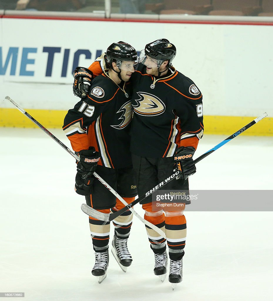 Nick Bonino #13 of the Anaheim Ducks celebrates with <a gi-track='captionPersonalityLinkClicked' href=/galleries/search?phrase=Bobby+Ryan+-+Ice+Hockey+Player&family=editorial&specificpeople=877359 ng-click='$event.stopPropagation()'>Bobby Ryan</a> #9 after scoring his third goal of the game to pick up the hat trick in the third period against the Los Angeles Kings at Honda Center on February 2, 2013 in Anaheim, California. The Ducks won 7-4.