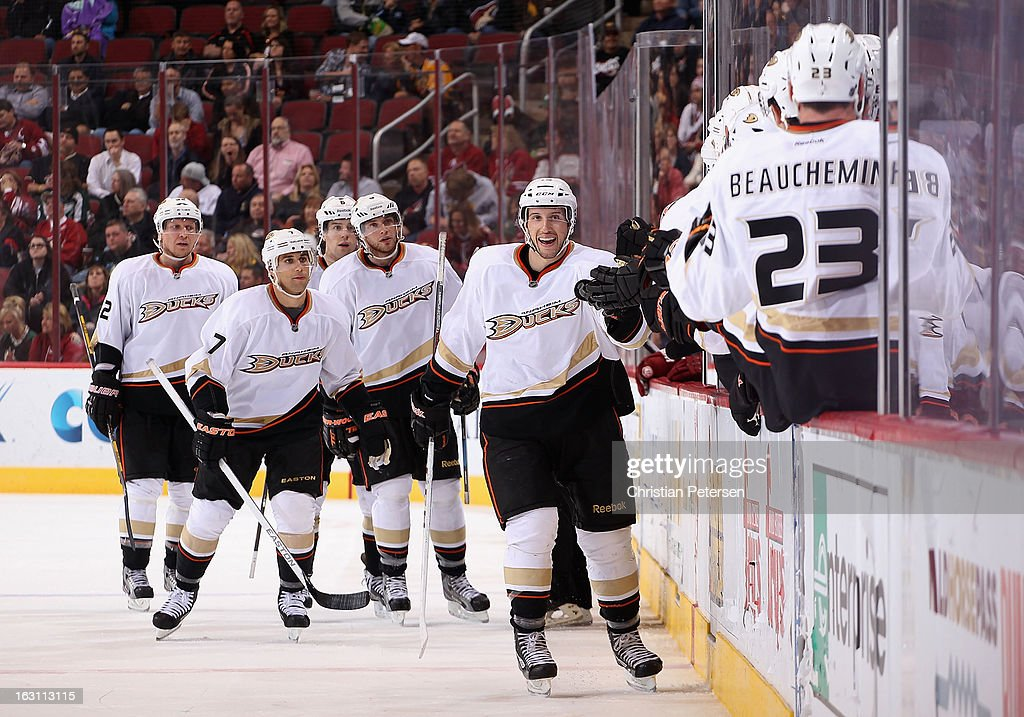 Nick Bonino #13 of the Anaheim Ducks celebrates with teammates on the bench after setting up a third period goal to <a gi-track='captionPersonalityLinkClicked' href=/galleries/search?phrase=Bobby+Ryan+-+Ice+Hockey+Player&family=editorial&specificpeople=877359 ng-click='$event.stopPropagation()'>Bobby Ryan</a> #9 (fourth from left) during the NHL game against the Phoenix Coyotes at Jobing.com Arena on March 4, 2013 in Glendale, Arizona. The Coyotes defeated the Ducks 5-4 in an overtime shootout.