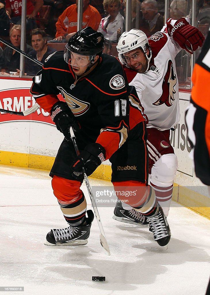 <a gi-track='captionPersonalityLinkClicked' href=/galleries/search?phrase=Nick+Bonino&family=editorial&specificpeople=5805660 ng-click='$event.stopPropagation()'>Nick Bonino</a> #13 of the Anaheim Ducks controls the puck from behind the net against <a gi-track='captionPersonalityLinkClicked' href=/galleries/search?phrase=David+Schlemko&family=editorial&specificpeople=3144738 ng-click='$event.stopPropagation()'>David Schlemko</a> #6 of the Phoenix Coyotes during the game on April 27, 2013 at Honda Center in Anaheim, California.
