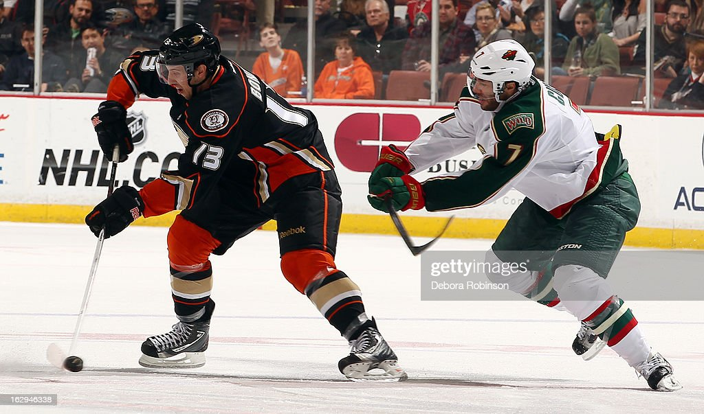 Nick Bonino #13 of the Anaheim Ducks handles the puck against <a gi-track='captionPersonalityLinkClicked' href=/galleries/search?phrase=Matt+Cullen&family=editorial&specificpeople=536122 ng-click='$event.stopPropagation()'>Matt Cullen</a> #7 of the Minnesota Wild on March 1, 2013 at Honda Center in Anaheim, California.