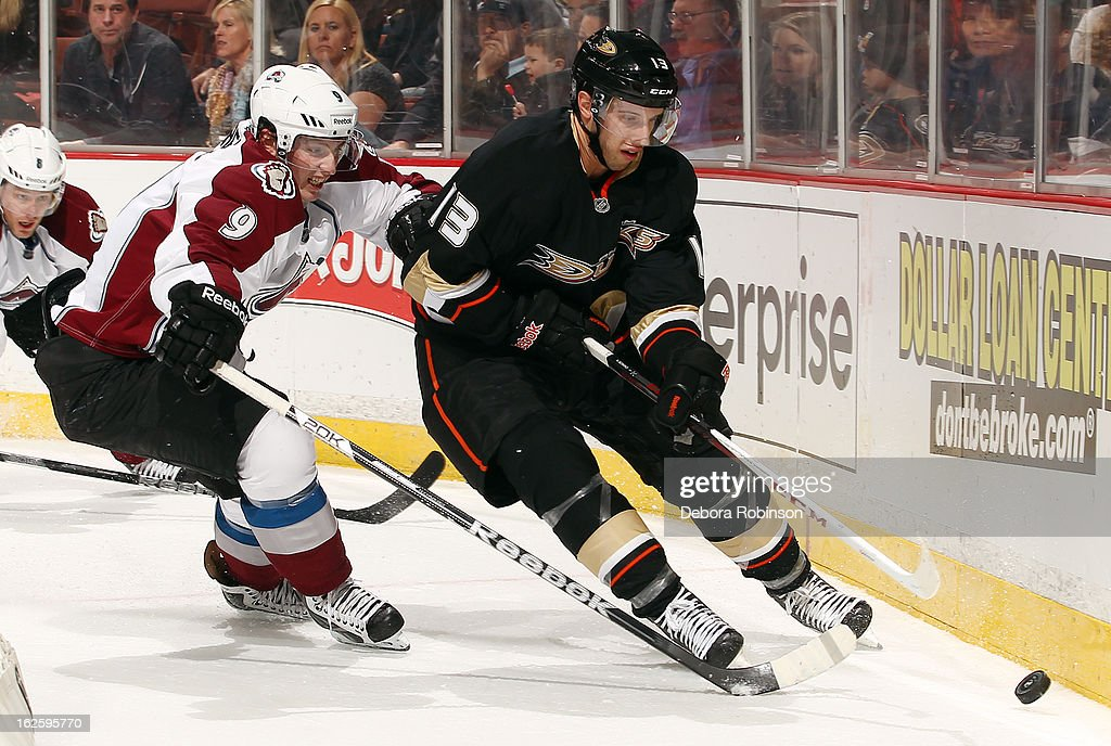 Nick Bonino #13 of the Anaheim Ducks handles the puck against <a gi-track='captionPersonalityLinkClicked' href=/galleries/search?phrase=Matt+Duchene&family=editorial&specificpeople=4819304 ng-click='$event.stopPropagation()'>Matt Duchene</a> #9 of the Colorado Avalanche on February 24, 2013 at Honda Center in Anaheim, California.