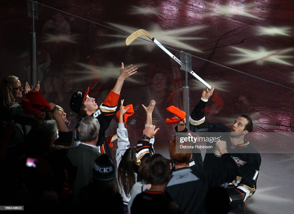 Nick Bonino #13 of the Anaheim Ducks hands a stick to a fan after the Ducks' 3-2 overtime win against the Detroit Red Wings in Game Five of the Western Conference Quarterfinals during the 2013 NHL Stanley Cup Playoffs at Honda Center on May 8, 2013 in Anaheim, California.