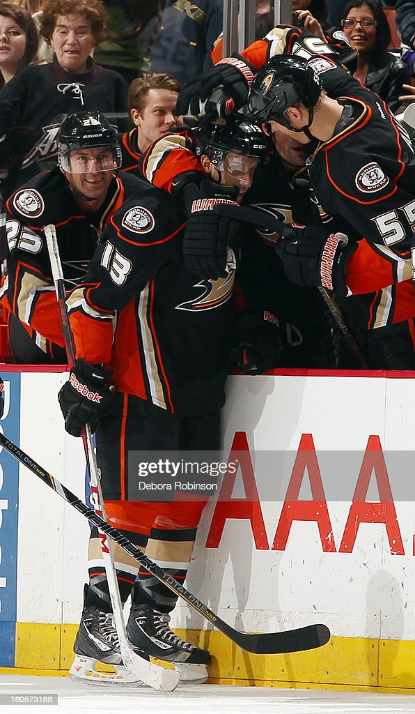 Nick Bonino #13 of the Anaheim Ducks is congratulated by <a gi-track='captionPersonalityLinkClicked' href=/galleries/search?phrase=Bryan+Allen+-+Jogador+de+h%C3%B3quei+no+gelo&family=editorial&specificpeople=206454 ng-click='$event.stopPropagation()'>Bryan Allen</a> #55 after Bonino scored his third goal of the game for his 1st career hat trick during the game against the Los Angeles Kings looks on during the game on February 2, 2013 at Honda Center in Anaheim, California.
