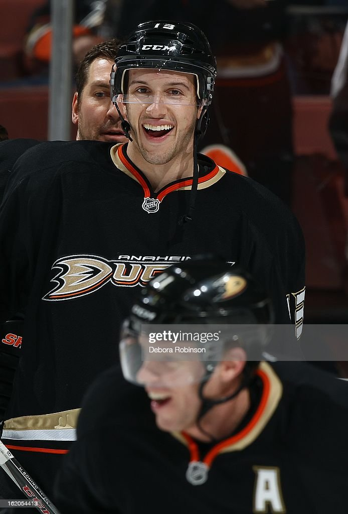 Nick Bonino #13 of the Anaheim Ducks laughs with teammate Saku Koivu #11 during pre-game against the Columbus Blue Jackets on February 18, 2013 at Honda Center in Anaheim, California.