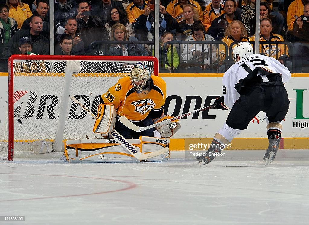 Nick Bonino #13 of the Anaheim Ducks scores a shootout goal against goalie <a gi-track='captionPersonalityLinkClicked' href=/galleries/search?phrase=Pekka+Rinne&family=editorial&specificpeople=2118342 ng-click='$event.stopPropagation()'>Pekka Rinne</a> #35 of the Nashville Predators at the Bridgestone Arena on February 16, 2013 in Nashville, Tennessee.