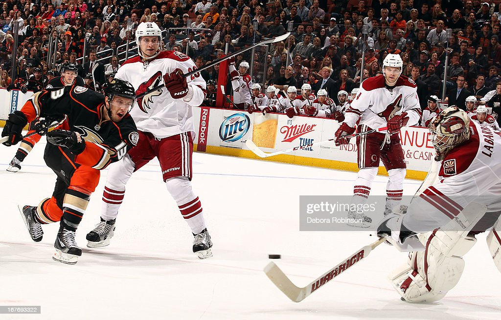 <a gi-track='captionPersonalityLinkClicked' href=/galleries/search?phrase=Nick+Bonino&family=editorial&specificpeople=5805660 ng-click='$event.stopPropagation()'>Nick Bonino</a> #13 of the Anaheim Ducks shoots and <a gi-track='captionPersonalityLinkClicked' href=/galleries/search?phrase=Jason+LaBarbera&family=editorial&specificpeople=240674 ng-click='$event.stopPropagation()'>Jason LaBarbera</a> #1 of the Phoenix Coyotes attempts to stop the puck with his stick during the game on April 27, 2013 at Honda Center in Anaheim, California.