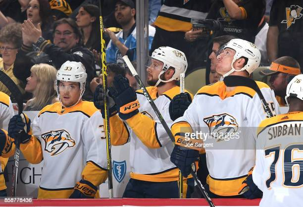 Nick Bonino of the Nashville Predators acknowledges the fan after being honored during an in game video tribute against the Pittsburgh Penguins at...