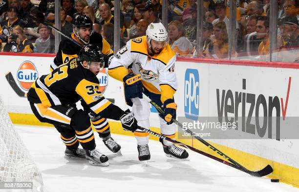 Nick Bonino of the Nashville Predators handles the puck against Greg McKegg of the Pittsburgh Penguins at PPG Paints Arena on October 7 2017 in...