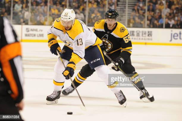 Nick Bonino of the Nashville Predators skates with the puck against Tim Schaller of the Boston Bruins at the TD Garden on October 5 2017 in Boston...