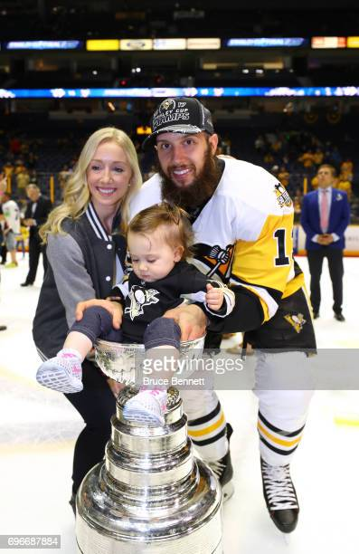 Nick Bonino of the Pittsburgh Penguins and his family pose with the Stanley Cup Trophy after they defeated the Nashville Predators 20 to win the 2017...