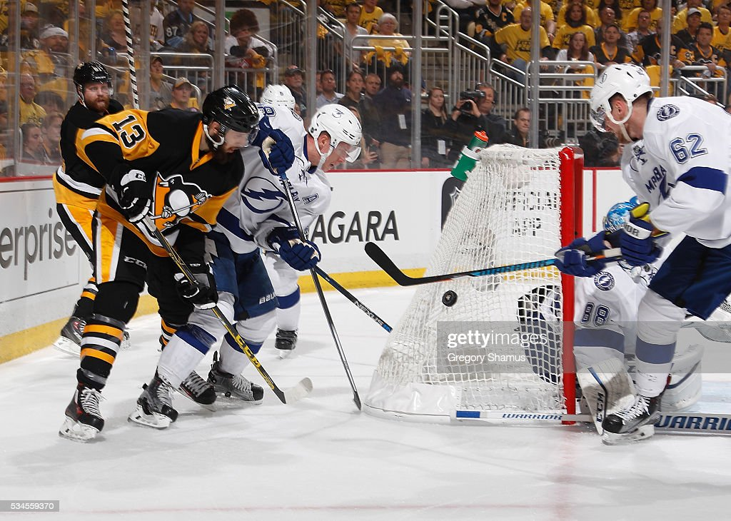 <a gi-track='captionPersonalityLinkClicked' href=/galleries/search?phrase=Nick+Bonino&family=editorial&specificpeople=5805660 ng-click='$event.stopPropagation()'>Nick Bonino</a> #13 of the Pittsburgh Penguins and Ondrej Palat #18 of the Tampa Bay Lightning battle for the loose puck in Game Seven of the Eastern Conference Final during the 2016 NHL Stanley Cup Playoffs at Consol Energy Center on May 26, 2016 in Pittsburgh, Pennsylvania.