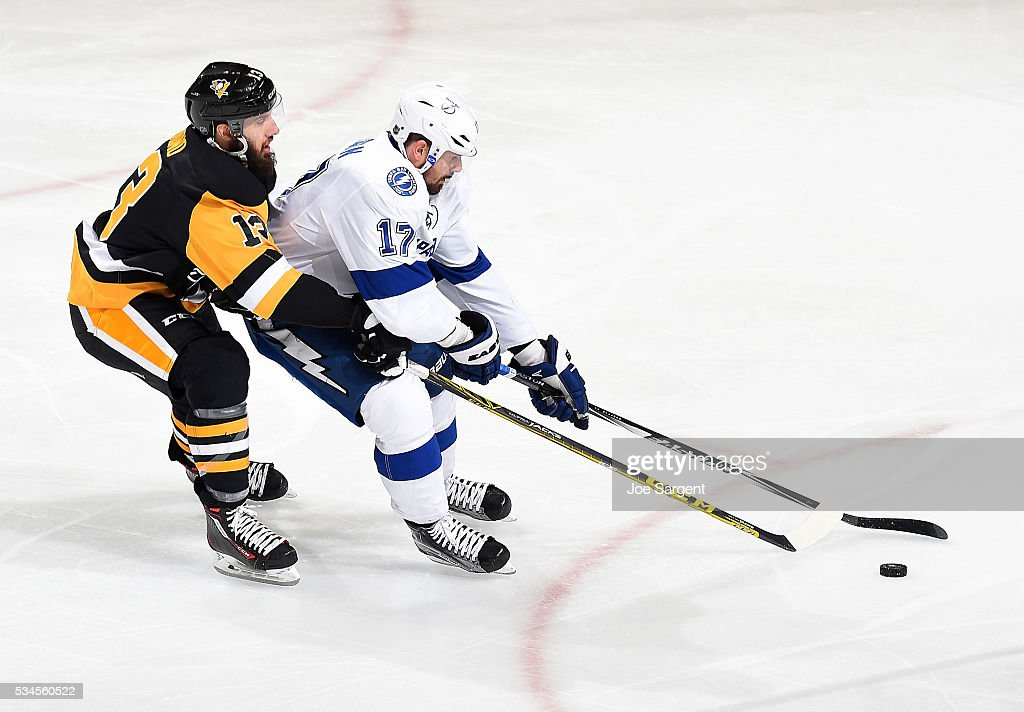<a gi-track='captionPersonalityLinkClicked' href=/galleries/search?phrase=Nick+Bonino&family=editorial&specificpeople=5805660 ng-click='$event.stopPropagation()'>Nick Bonino</a> #13 of the Pittsburgh Penguins battles for the puck against Alex Killorn #17 of the Tampa Bay Lightning in Game Seven of the Eastern Conference Final during the 2016 NHL Stanley Cup Playoffs at Consol Energy Center on May 26, 2016 in Pittsburgh, Pennsylvania.