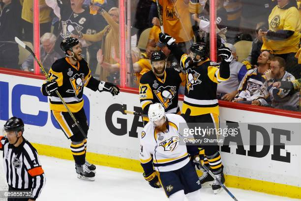 Nick Bonino of the Pittsburgh Penguins celebrates a goal during the first period with teammates Bryan Rust and Carter Rowney of the Pittsburgh...