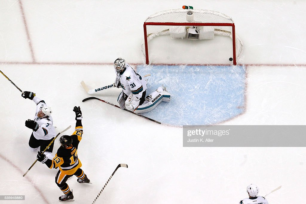 <a gi-track='captionPersonalityLinkClicked' href=/galleries/search?phrase=Nick+Bonino&family=editorial&specificpeople=5805660 ng-click='$event.stopPropagation()'>Nick Bonino</a> #13 of the Pittsburgh Penguins celebrates after scoring a third period goal against <a gi-track='captionPersonalityLinkClicked' href=/galleries/search?phrase=Martin+Jones+-+Ice+Hockey+Player&family=editorial&specificpeople=12318960 ng-click='$event.stopPropagation()'>Martin Jones</a> #31 of the San Jose Sharks in Game One of the 2016 NHL Stanley Cup Final at Consol Energy Center on May 30, 2016 in Pittsburgh, Pennsylvania.