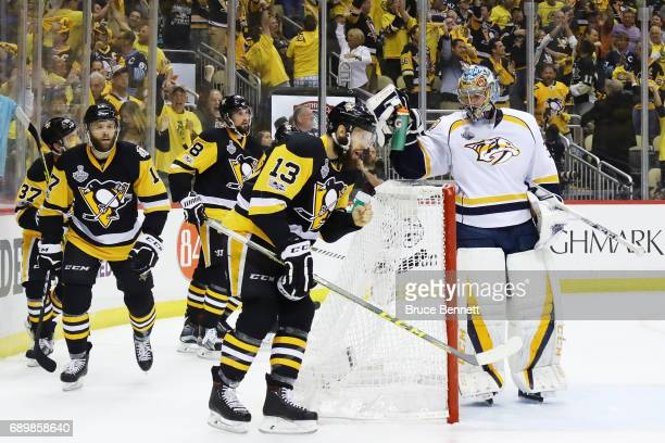 Nick Bonino of the Pittsburgh Penguins celebrates during the first period as Pekka Rinne of the Nashville Predators looks on in Game One of the 2017...