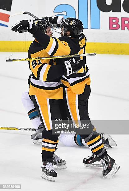 Nick Bonino of the Pittsburgh Penguins celebrates with Phil Kessel after scoring a third period goal against the San Jose Sharks in Game One of the...