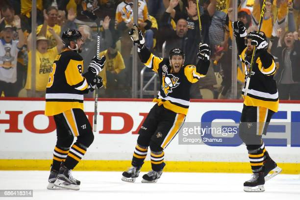 Nick Bonino of the Pittsburgh Penguins celebrates with teammates Brian Dumoulin and Carter Rowney after Bryan Rust scored a goal against Craig...