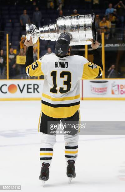 Nick Bonino of the Pittsburgh Penguins celebrates with the Stanley Cup trophy after they defeated the Nashville Predators 20 in Game Six of the 2017...