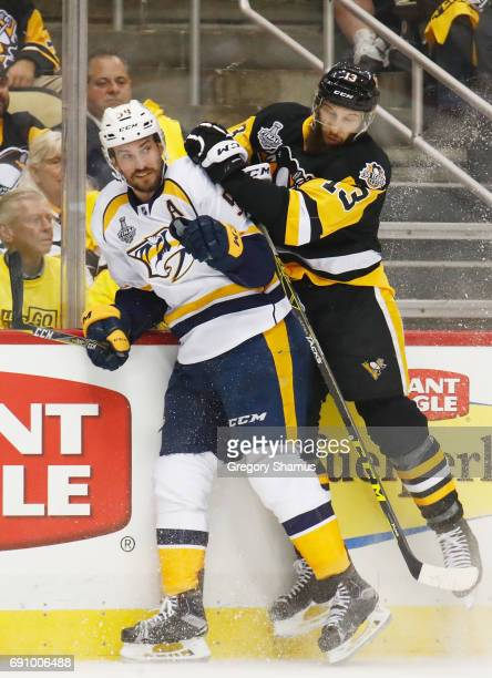 Nick Bonino of the Pittsburgh Penguins checks Roman Josi of the Nashville Predators during the first period in Game Two of the 2017 NHL Stanley Cup...