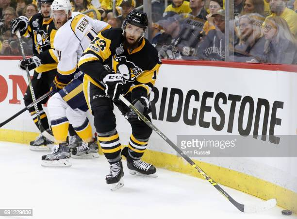 Nick Bonino of the Pittsburgh Penguins controls the puck during the second period of Game Two of the 2017 NHL Stanley Cup Final against the Nashville...