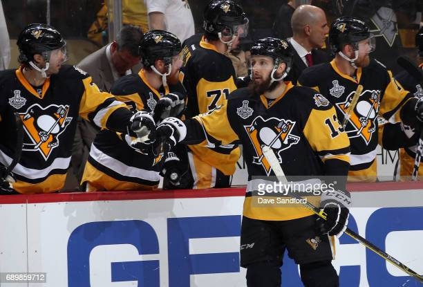 Nick Bonino of the Pittsburgh Penguins is congratulated after scoring a goal in the first period of Game One of the 2017 NHL Stanley Cup Final at PPG...