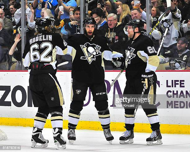 Nick Bonino of the Pittsburgh Penguins is congratulated by teammates after scoring a goal against the Nashville Predators at Consol Energy Center on...