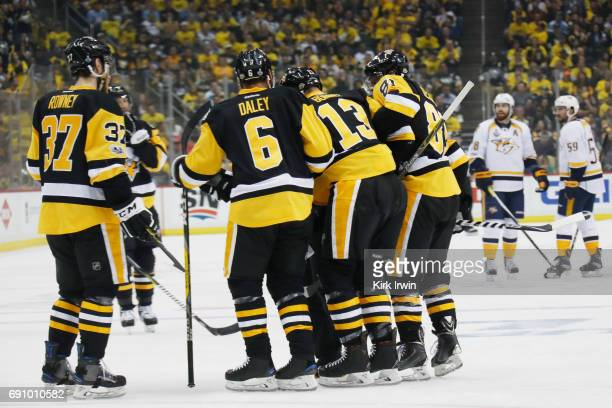 Nick Bonino of the Pittsburgh Penguins is helped off the ice by teammates after blocking a shot during the first period in Game Two of the 2017 NHL...