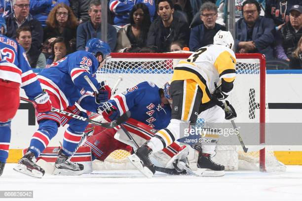 Nick Bonino of the Pittsburgh Penguins knocks the puck past Magnus Hellberg of the New York Rangers for a goal in the first period at Madison Square...