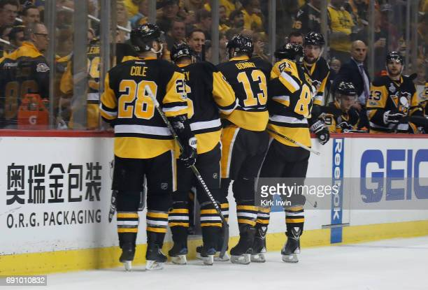 Nick Bonino of the Pittsburgh Penguins reacts with teammates during the first period against the Nashville Predators in Game Two of the 2017 NHL...