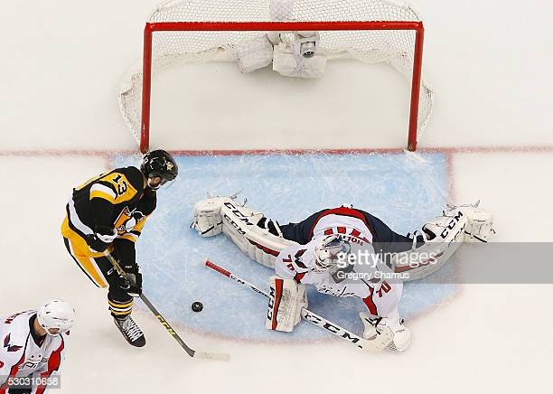 Nick Bonino of the Pittsburgh Penguins scores a game winning overtime goal in front of Braden Holtby of the Washington Capitals in Game Six of the...