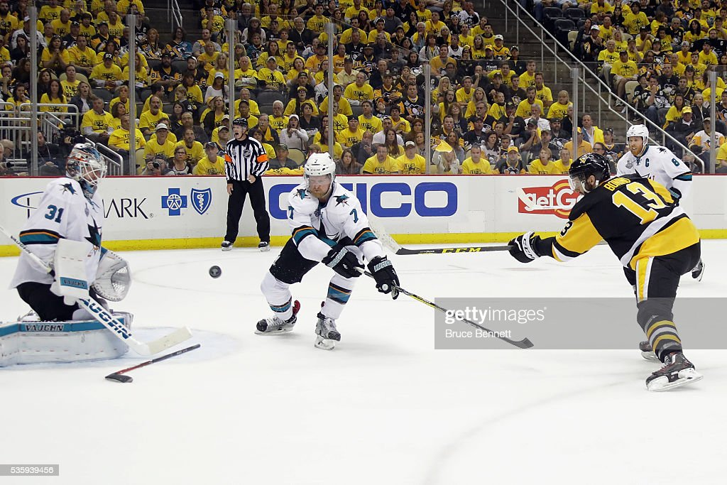 <a gi-track='captionPersonalityLinkClicked' href=/galleries/search?phrase=Nick+Bonino&family=editorial&specificpeople=5805660 ng-click='$event.stopPropagation()'>Nick Bonino</a> #13 of the Pittsburgh Penguins scores a third period goal against <a gi-track='captionPersonalityLinkClicked' href=/galleries/search?phrase=Martin+Jones+-+Ice+Hockey+Player&family=editorial&specificpeople=12318960 ng-click='$event.stopPropagation()'>Martin Jones</a> #31 of the San Jose Sharks in Game One of the 2016 NHL Stanley Cup Final at Consol Energy Center on May 30, 2016 in Pittsburgh, Pennsylvania.