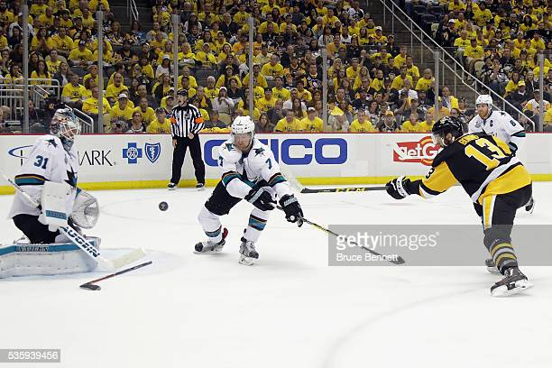 Nick Bonino of the Pittsburgh Penguins scores a third period goal against Martin Jones of the San Jose Sharks in Game One of the 2016 NHL Stanley Cup...