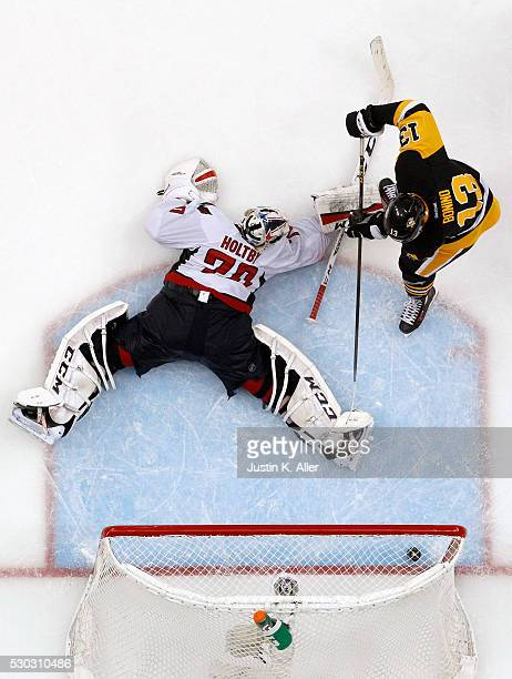 Nick Bonino of the Pittsburgh Penguins scores past Braden Holtby of the Washington Capitals to win 43 in overtime in Game Six of the Eastern...