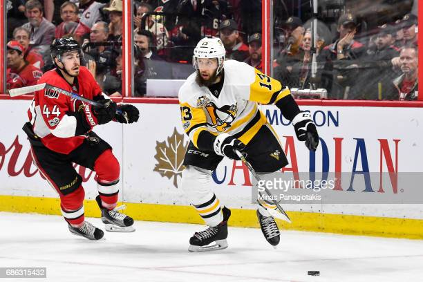 Nick Bonino of the Pittsburgh Penguins skates after the puck against JeanGabriel Pageau of the Ottawa Senators in Game Four of the Eastern Conference...