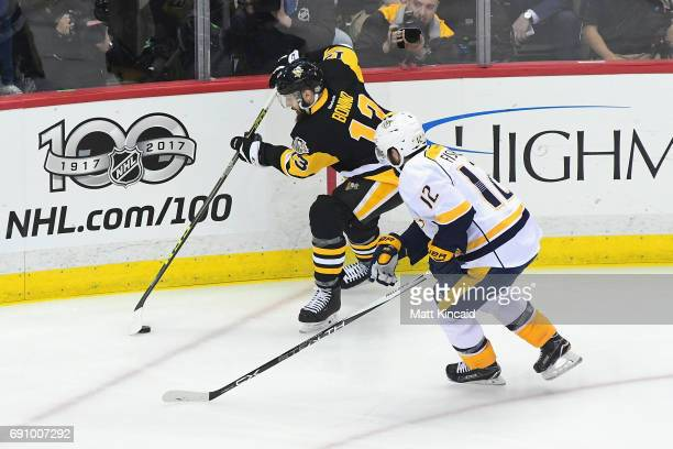 Nick Bonino of the Pittsburgh Penguins skates against Mike Fisher of the Nashville Predators during the first period in Game Two of the 2017 NHL...