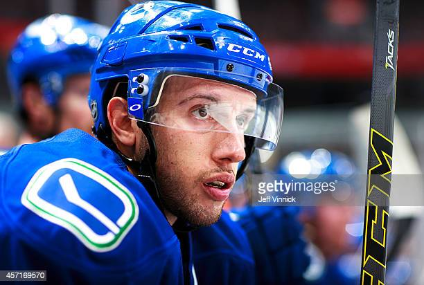 Nick Bonino of the Vancouver Canucks looks on from the bench during their NHL game against the Edmonton Oilers at Rogers Arena October 11 2014 in...