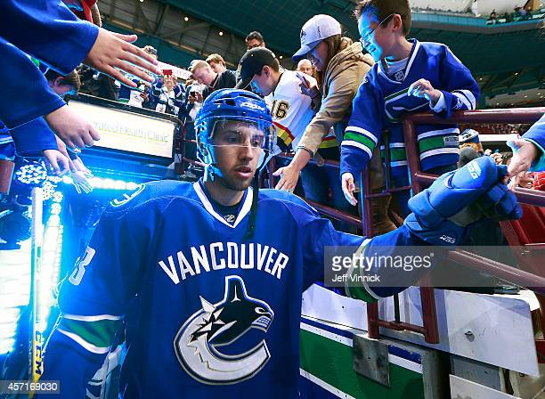 Nick Bonino of the Vancouver Canucks walks to the ice during their NHL game against the Edmonton Oilers at Rogers Arena October 11 2014 in Vancouver...